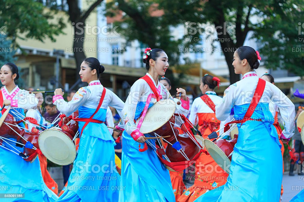 South Korean musicians in traditional costumes participating in festival's parade stock photo