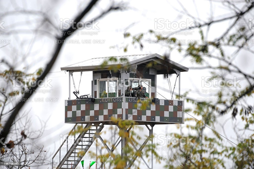 South Korean Soldiers in DMZ watching North Korea stock photo