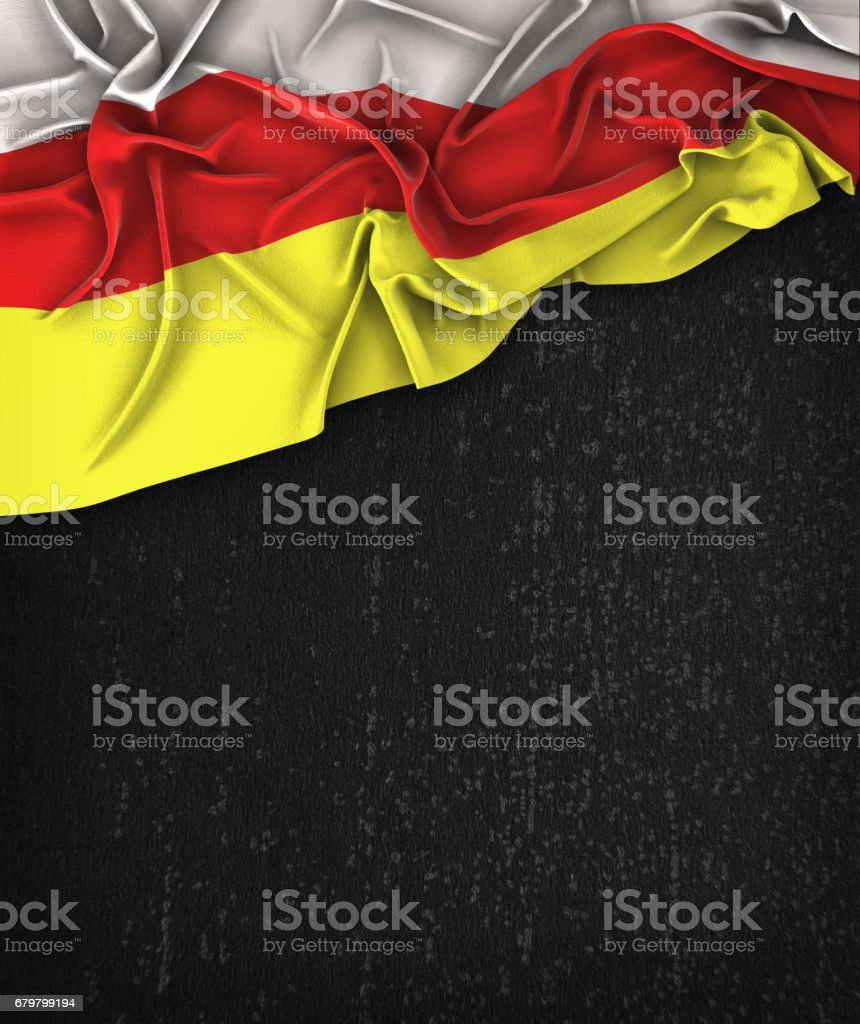 South Ossetia Flag Vintage on a Grunge Black Chalkboard With Space For Text stock photo