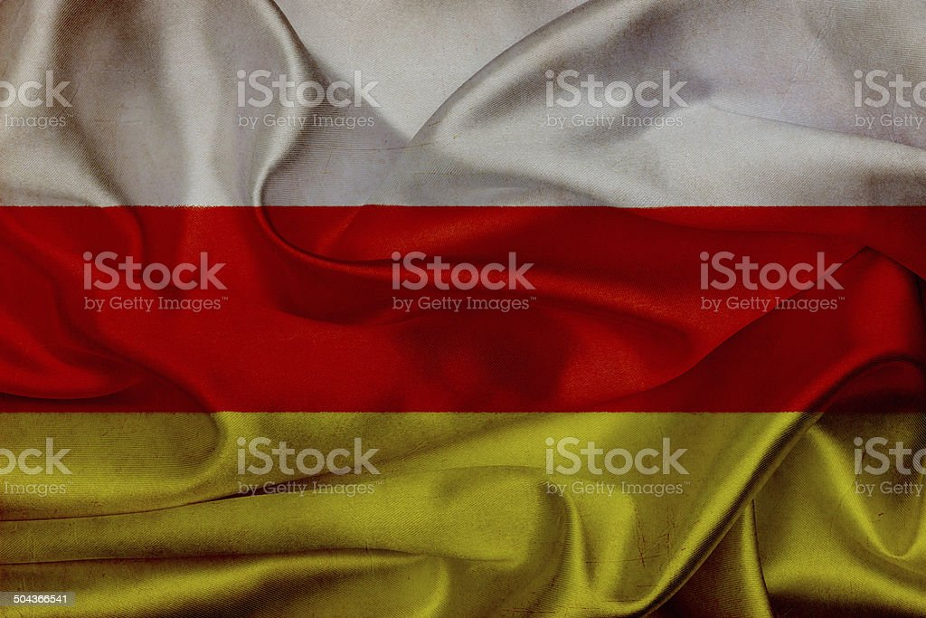 South Ossetia grunge waving flag stock photo