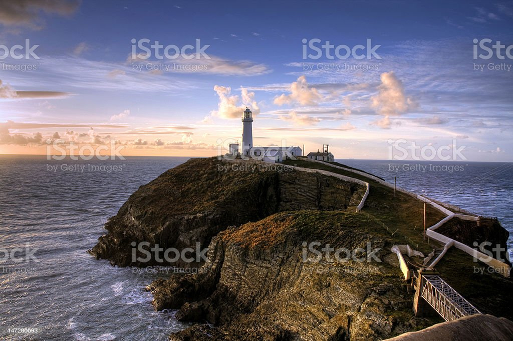 South Stack lighthouse next to the coast stock photo
