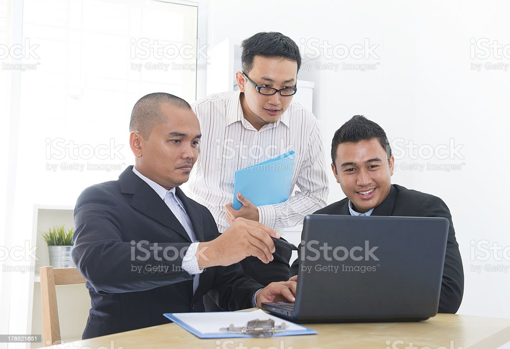 Southeast Asian business team royalty-free stock photo