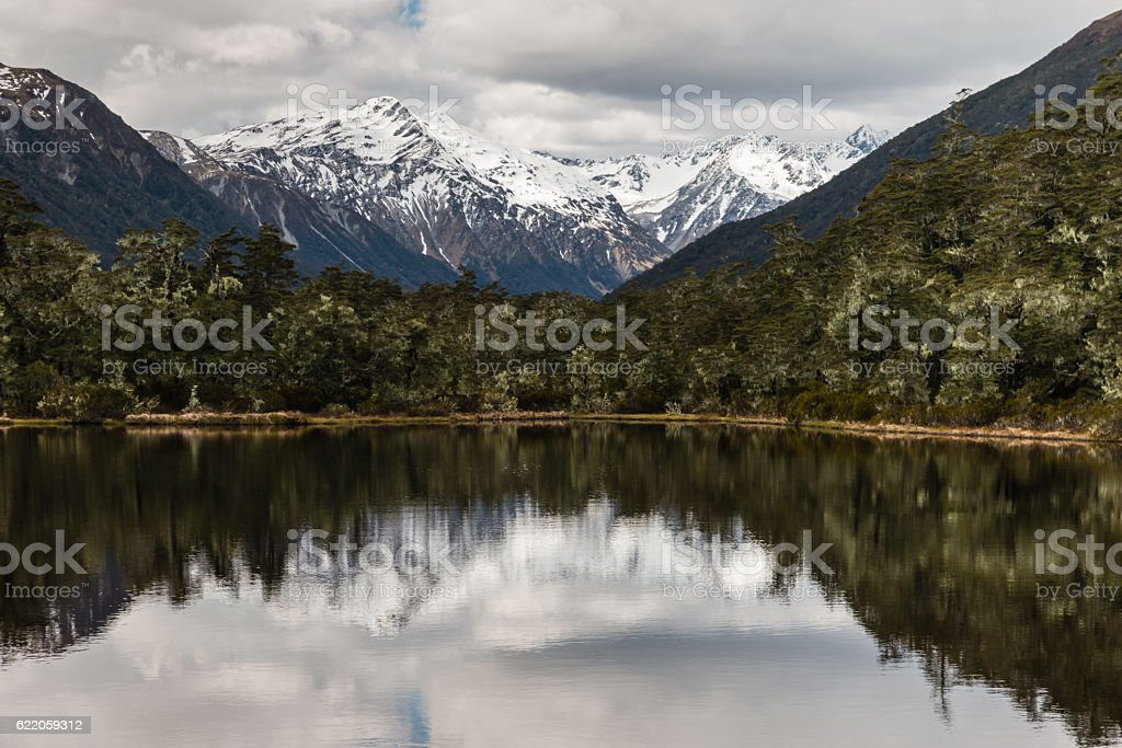 Souther Alps peaks reflecting in lake in New Zealand stock photo