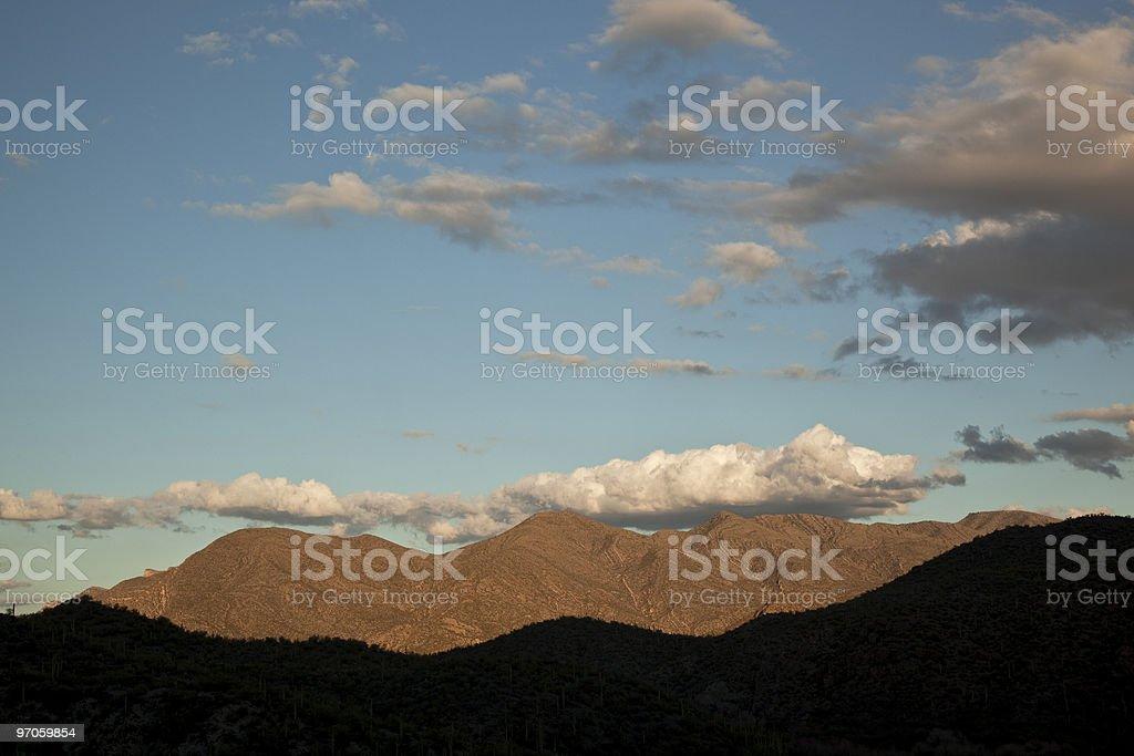 southern Arizona geology: uplifting visible in lit mountains stock photo