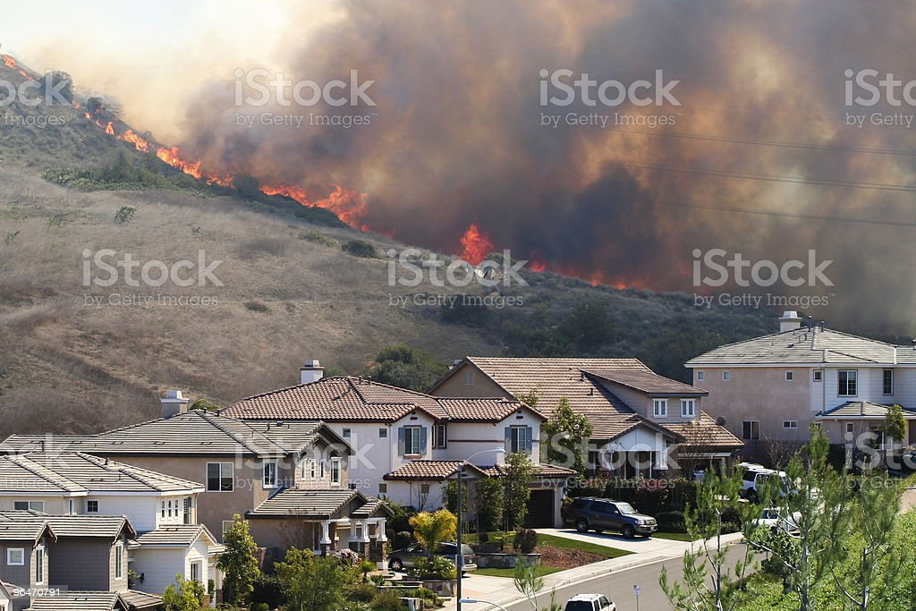 Southern California brush fire near houses stock photo