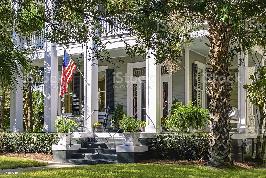 Southern home with large, elegant front porch stock photo