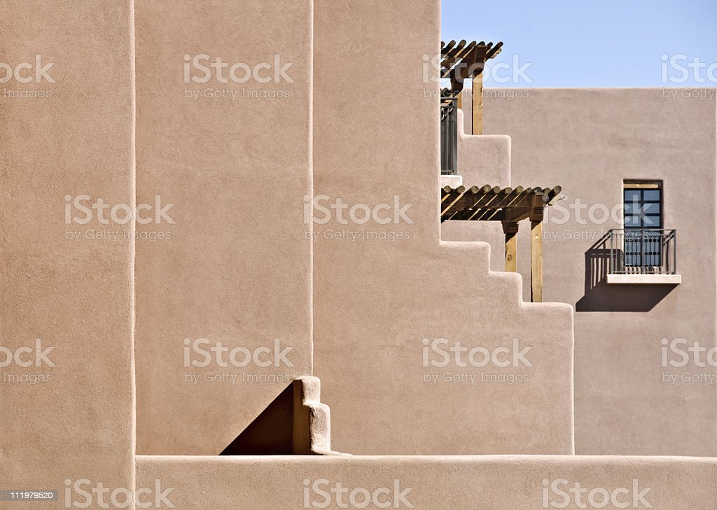 Southwest Santa Fe Adobe Stucco Building with Wooden Roof Beams royalty-free stock photo