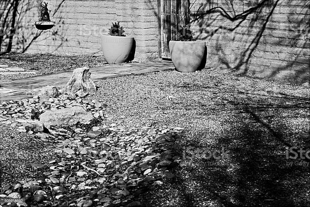 Southwest Xeriscape Entry and Adobe Wall, Full Frame B/W Image stock photo