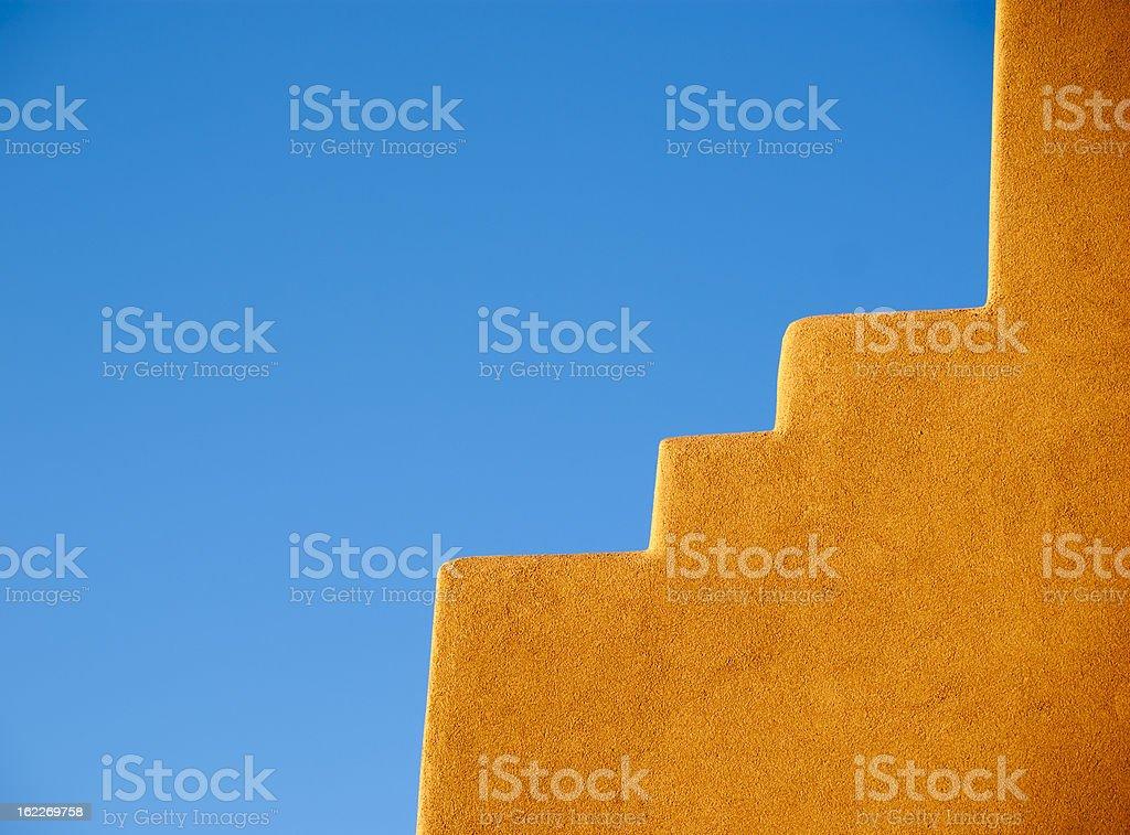 Southwestern Adobe wall and blue sky royalty-free stock photo