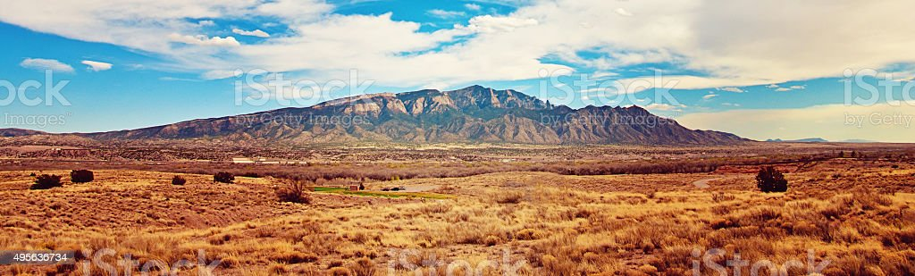 Southwestern Landscape with Sandia Mountains and Beautiful Sky, New Mexico stock photo