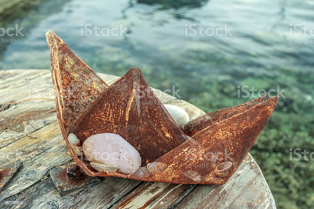 Souvenir boat made of rusty metal wire gauze mesh stock photo