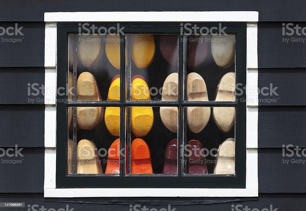 Souvenir clogs behind a window of an old Dutch house stock photo