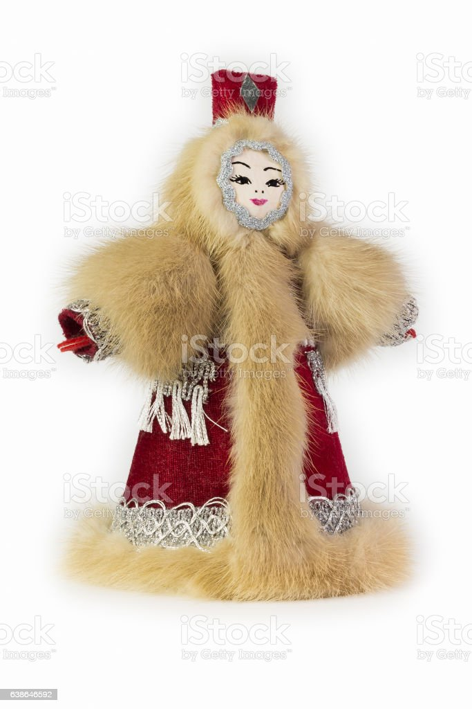 souvenir in the form of girl in a fur garment stock photo