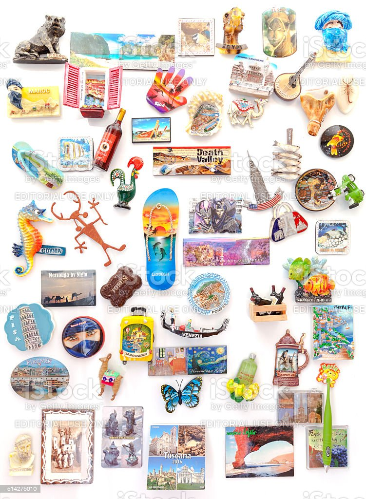 Souvenir magnets from all over the world on refrigerator. stock photo
