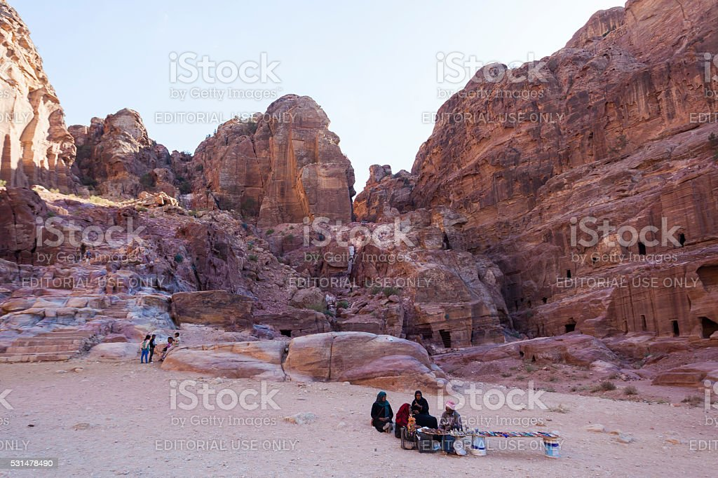 Souvenir sellers in front of street facades tombs. Petra. Jordan. stock photo