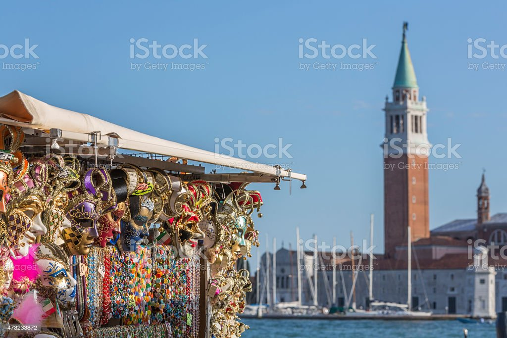 Souvenirs shop in Venise  with San Giorgio di Maggiore church stock photo