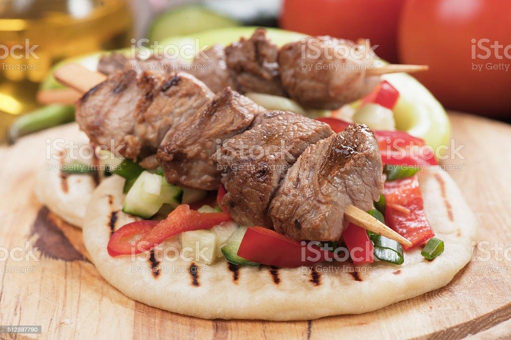 Souvlaki or kebab on pita bread stock photo