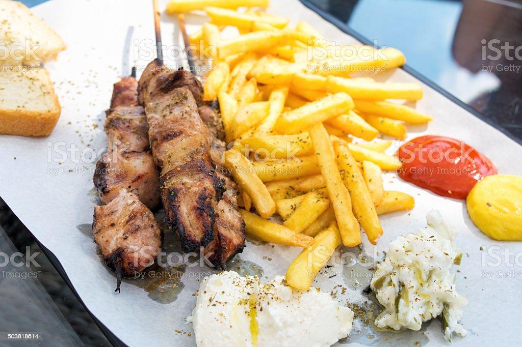 Souvlaki with french fries stock photo