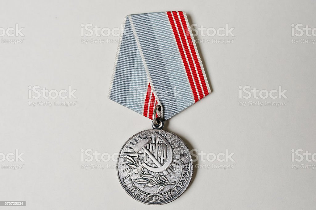 Soviet medal for labor veteran on white background stock photo