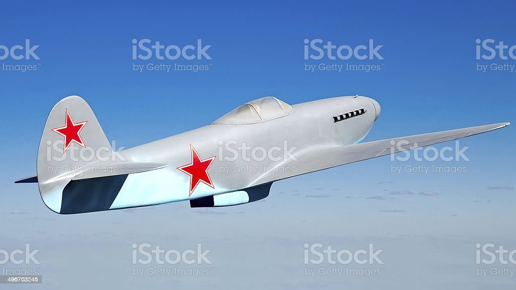 Soviet military fighter Yak-3 (layout) on blue sky background stock photo