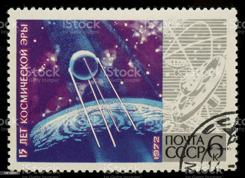 Soviet postage stamp with planets, space and sputnik stock photo
