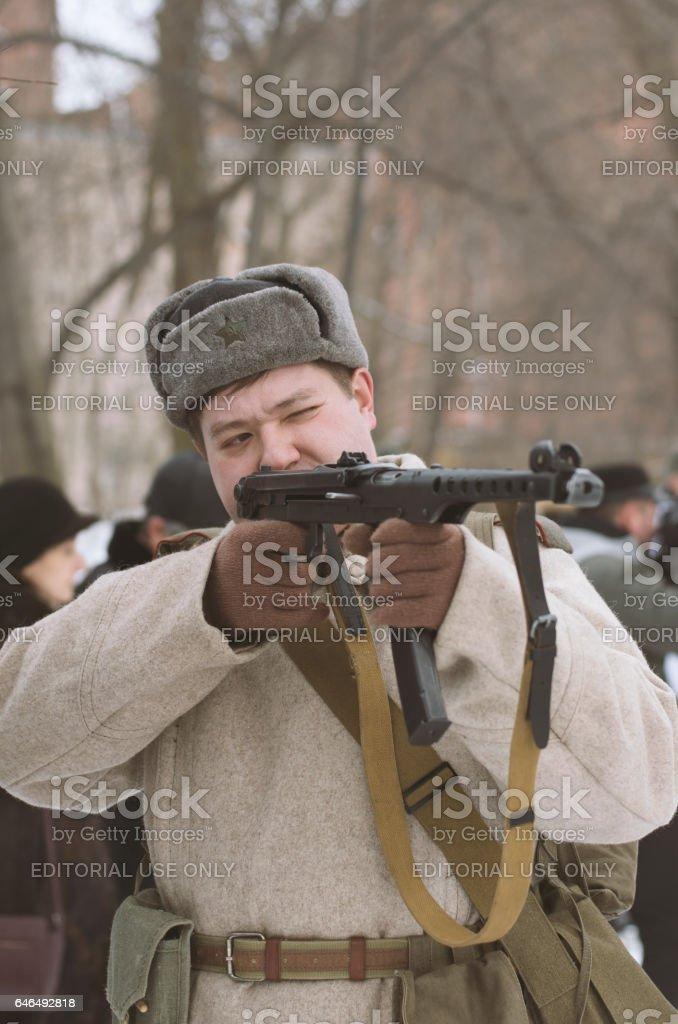Soviet soldier checks the gun looking through the scope. stock photo