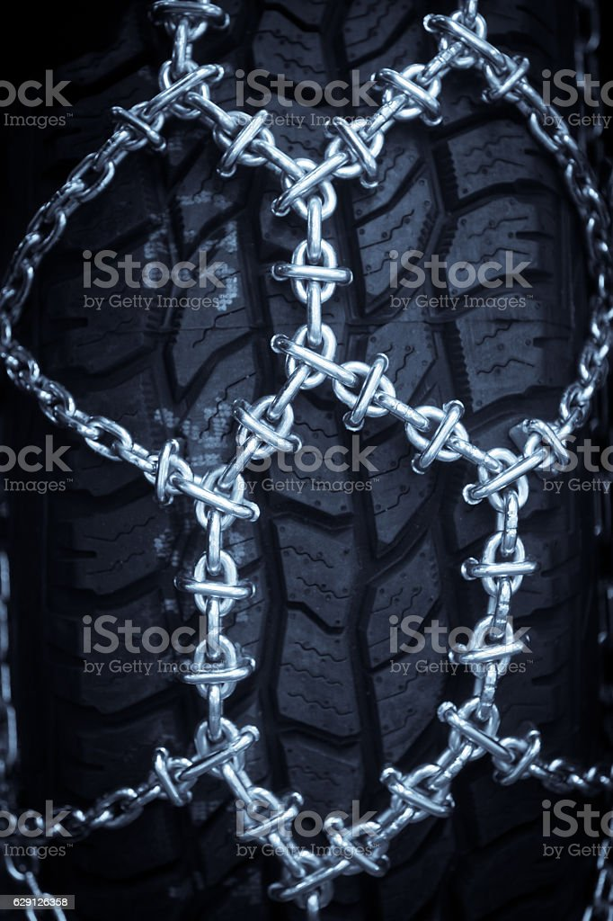 Sow chains on tires stock photo