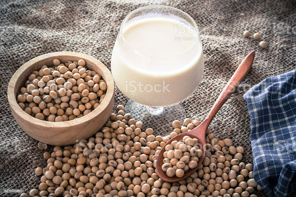 Soy beans and soy milk on table stock photo