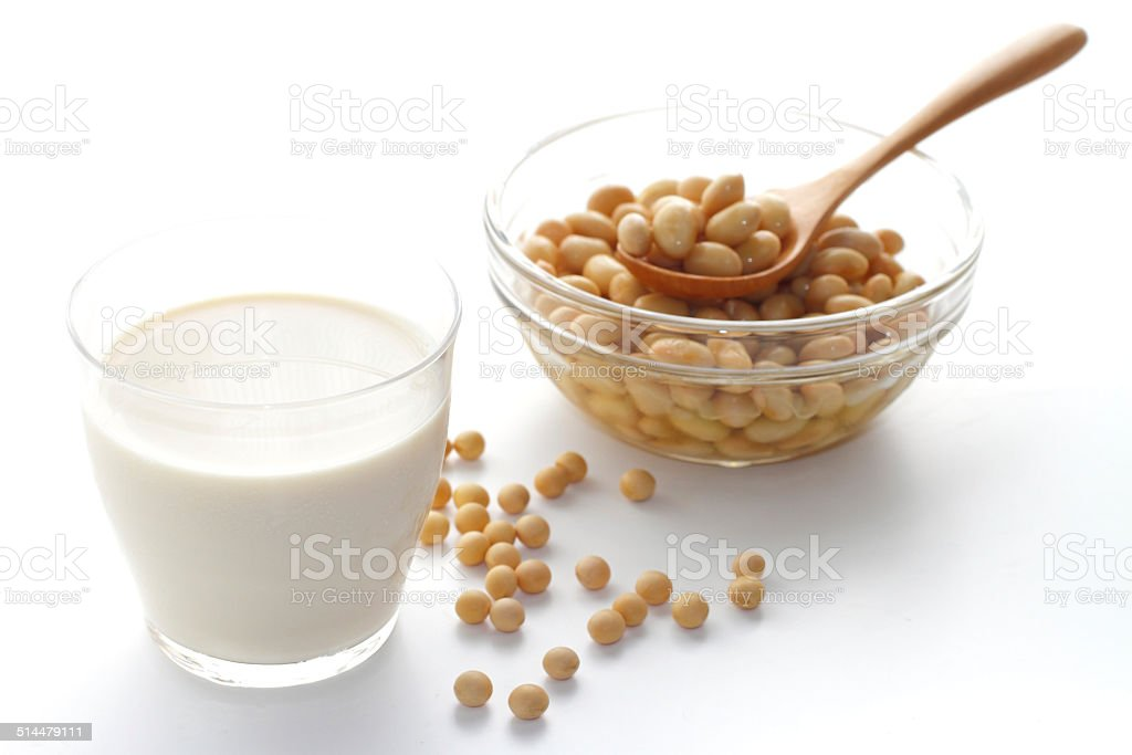 soy milk with soy beans over white stock photo