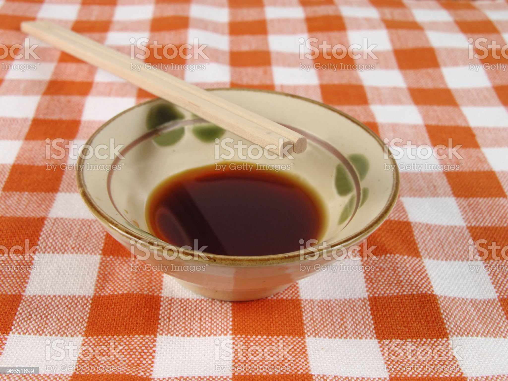 Soy sauce and chopsticks on a home table royalty-free stock photo