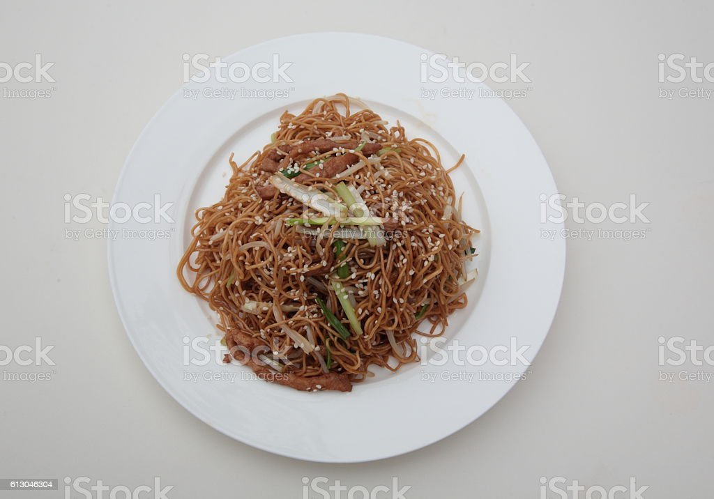 Soy sauce fried noodle with bean sprouts and pork stock photo