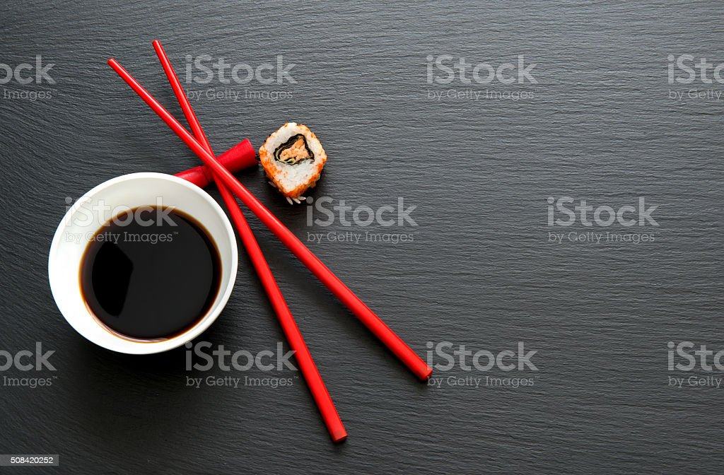 Soy sauce with red chopsticks stock photo