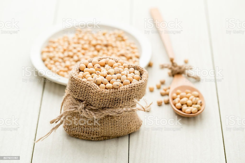 Soya beans in a sack stock photo