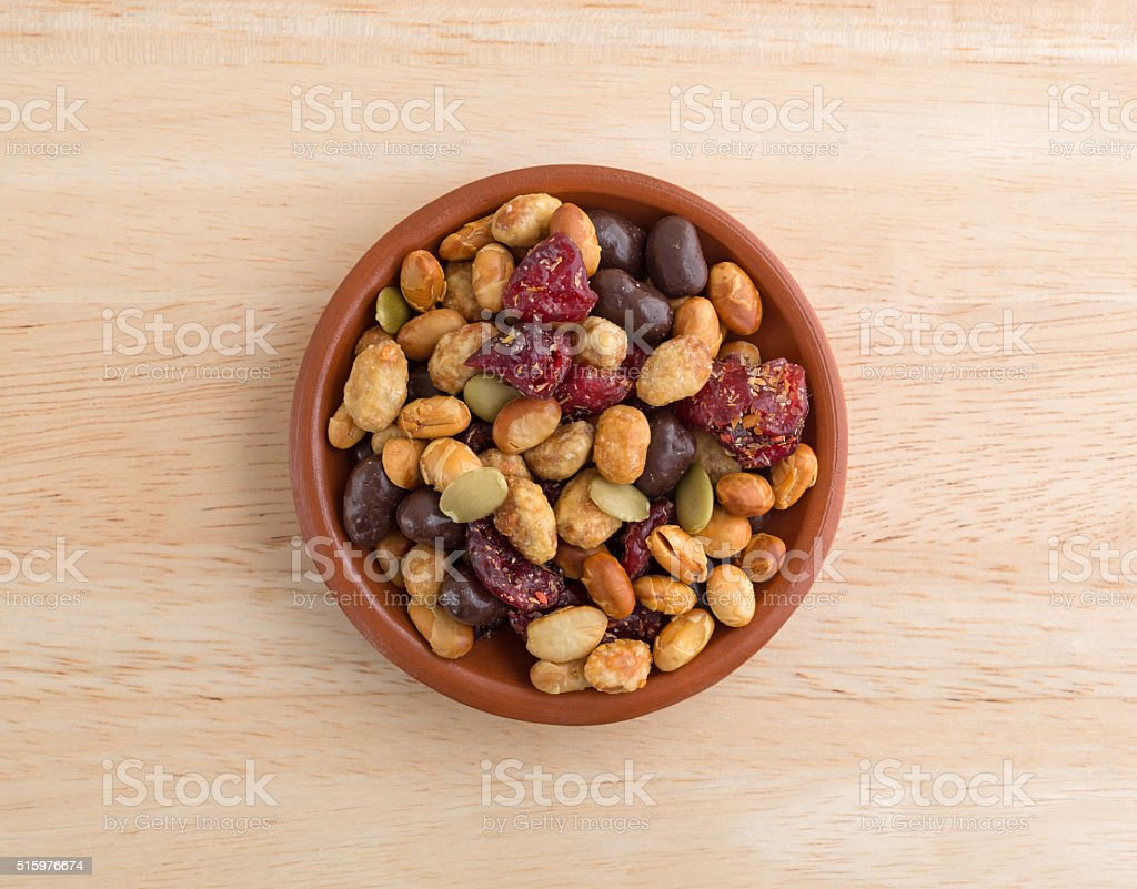 Soybean cranberry trail mix in small bowl on table stock photo