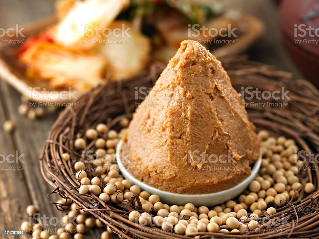 A soybean paste on a white dish surrounded by beans stock photo
