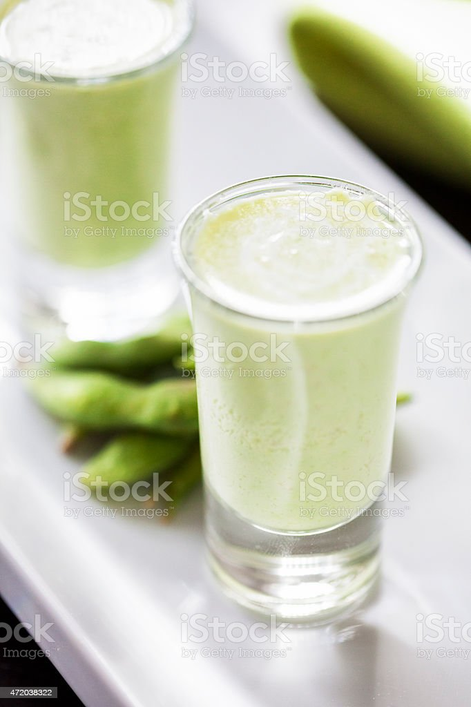 Soybean soup appetizers in shot glasses stock photo