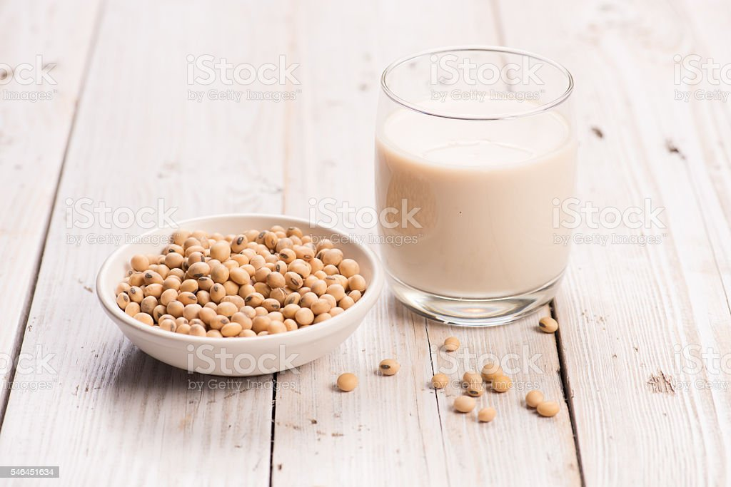 Soybeans and soy milk in a glass. stock photo