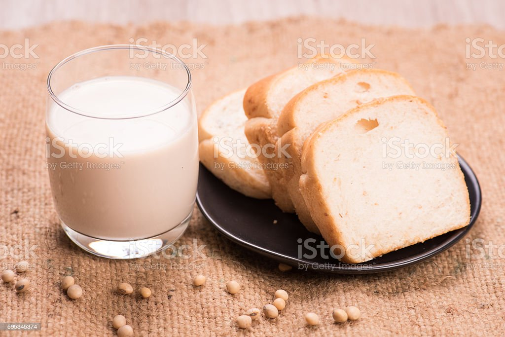 Soybeans and soy milk in a glass with fresh buns stock photo