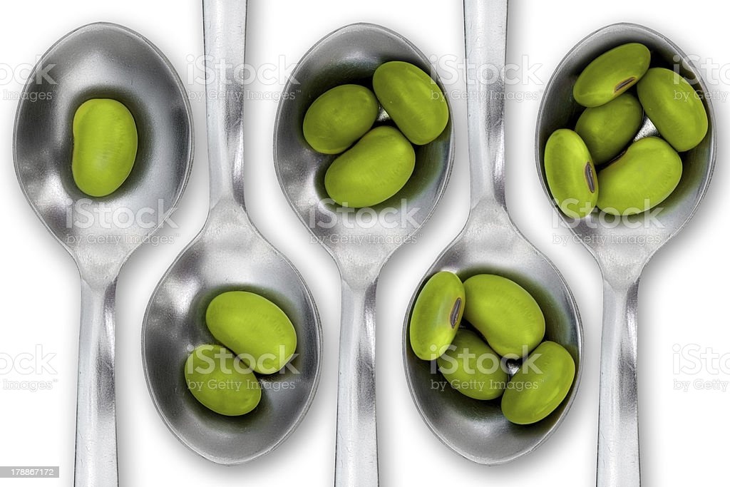 Soybeans in many spoons royalty-free stock photo
