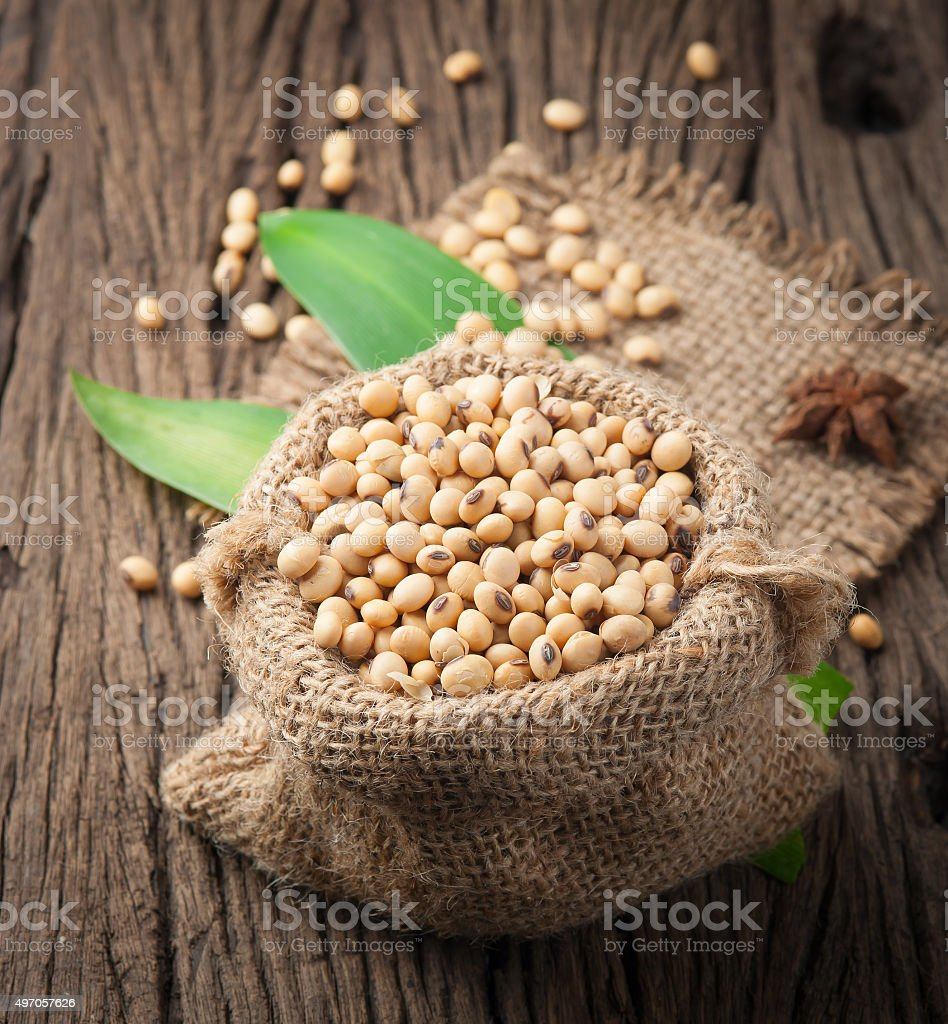 Soybeans on old wood background, stock photo