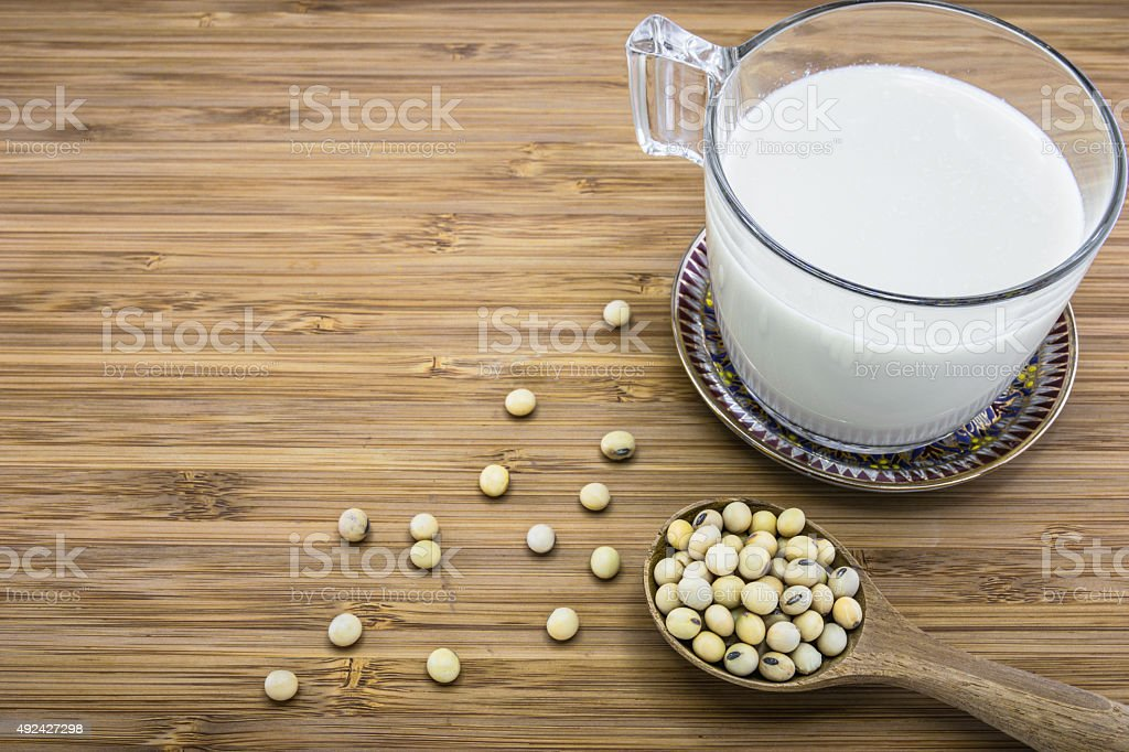 Soymilk from soybeans stock photo