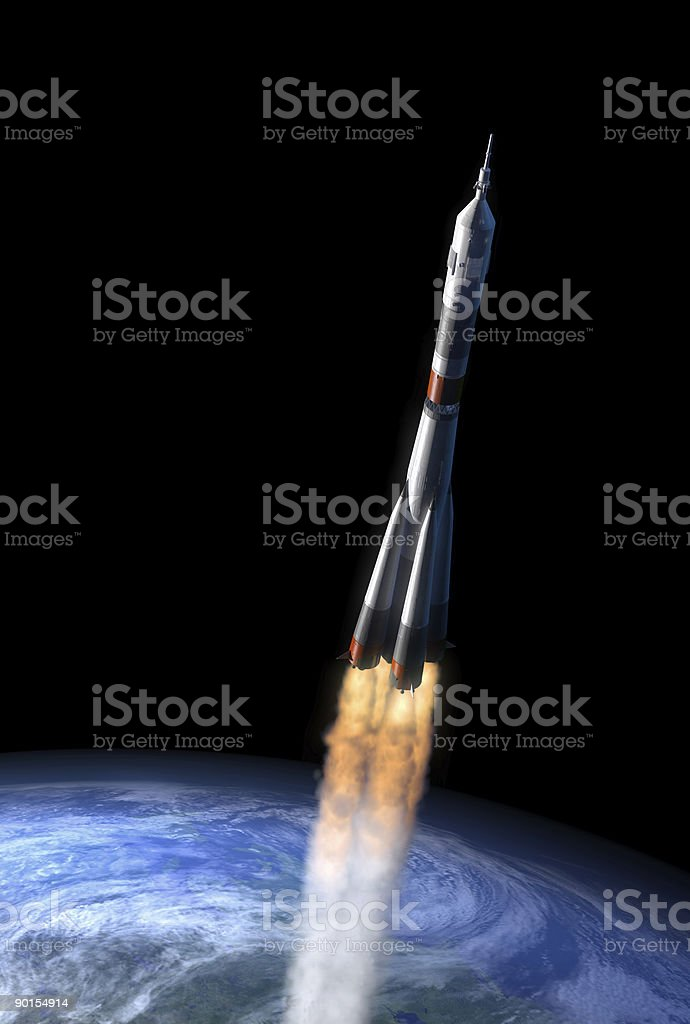 Soyuz. space rocket and earth islolated on black royalty-free stock photo