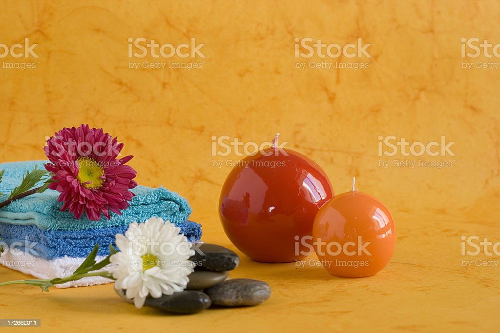 Spa accessories towel pampering stuff Candles massage stones and flowers royalty-free stock photo