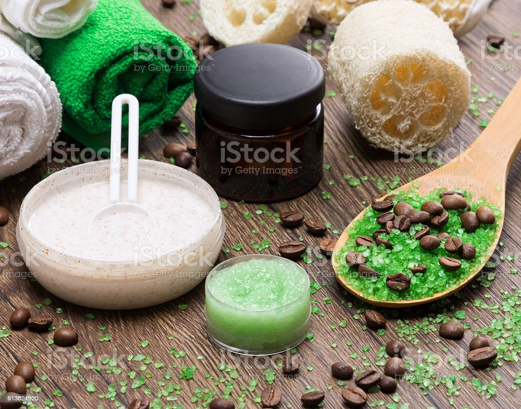 Spa and cellulite busting products on wooden surface stock photo