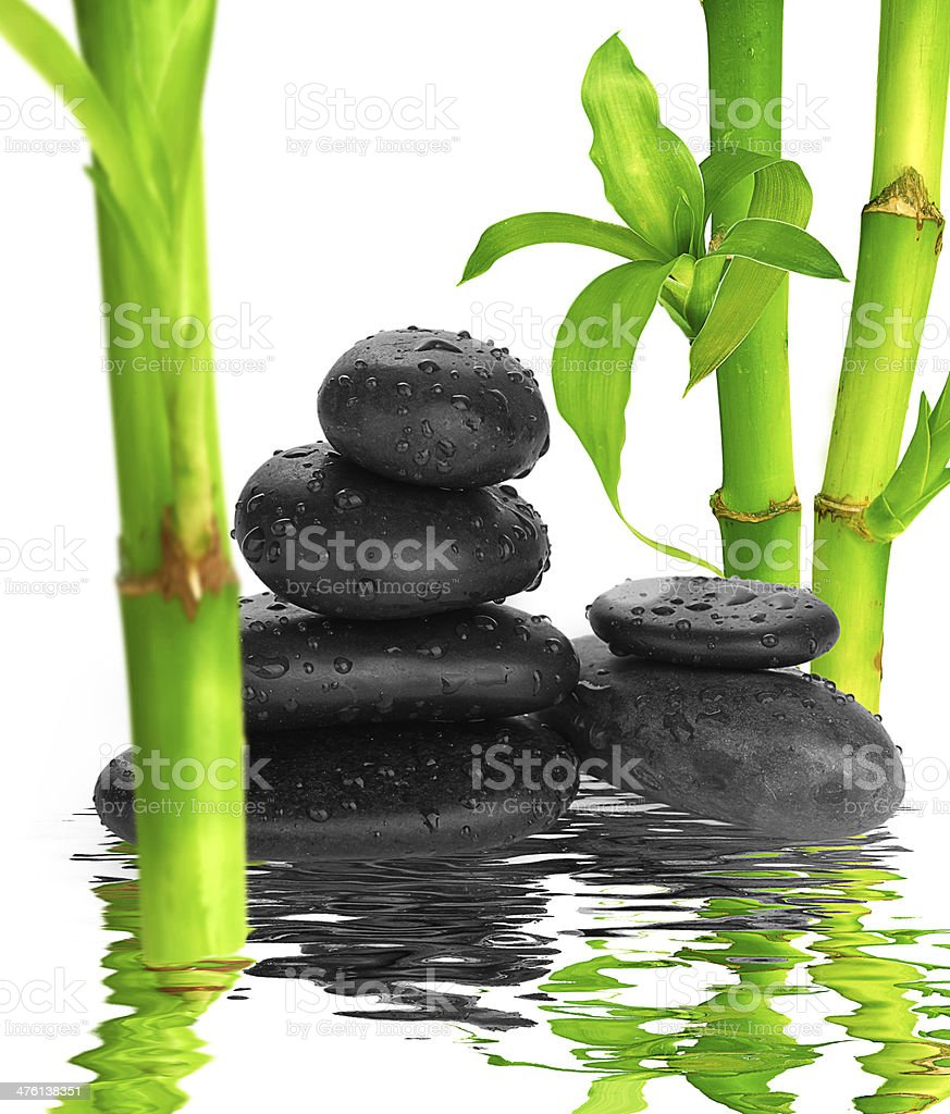 spa Background -  black stones and bamboo on water stock photo
