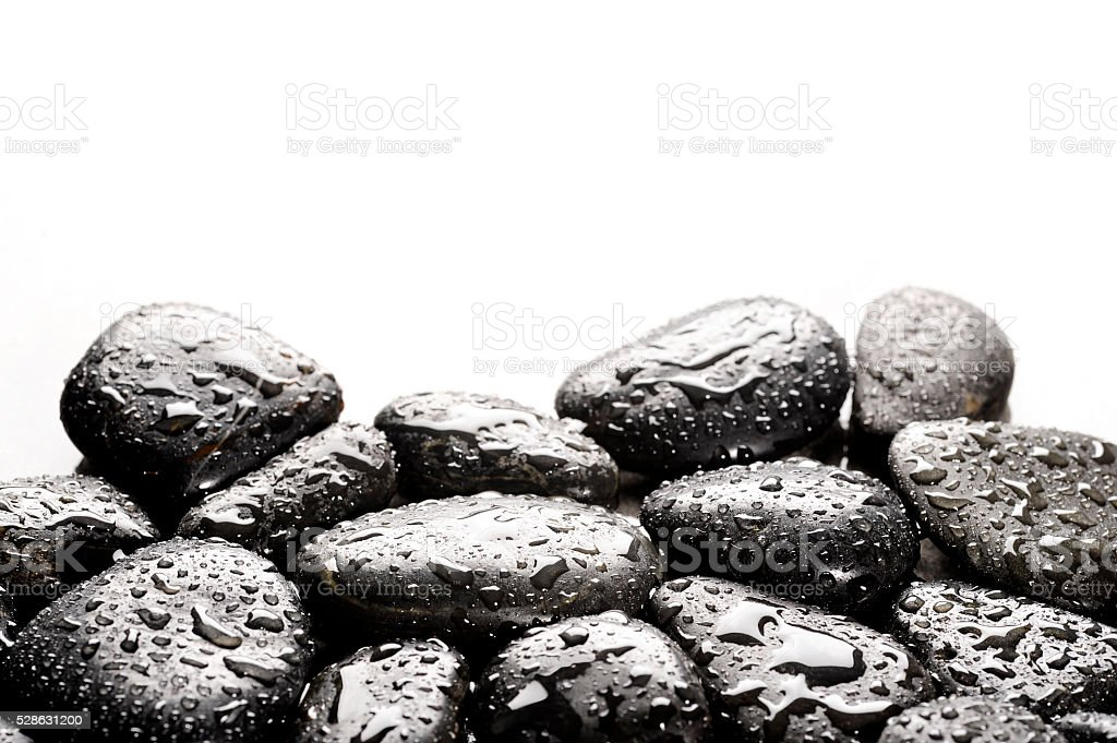 spa basalt stones with water drops stock photo