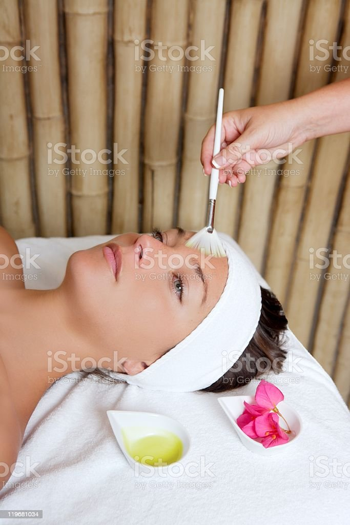 spa beauty facial treatment oil brush and flowers royalty-free stock photo