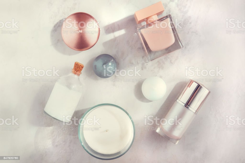 Spa beauty products on white marble table flatlay stock photo