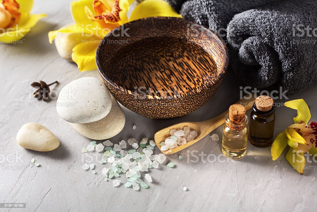 Spa composition with sea salt, flowers and massage oil stock photo