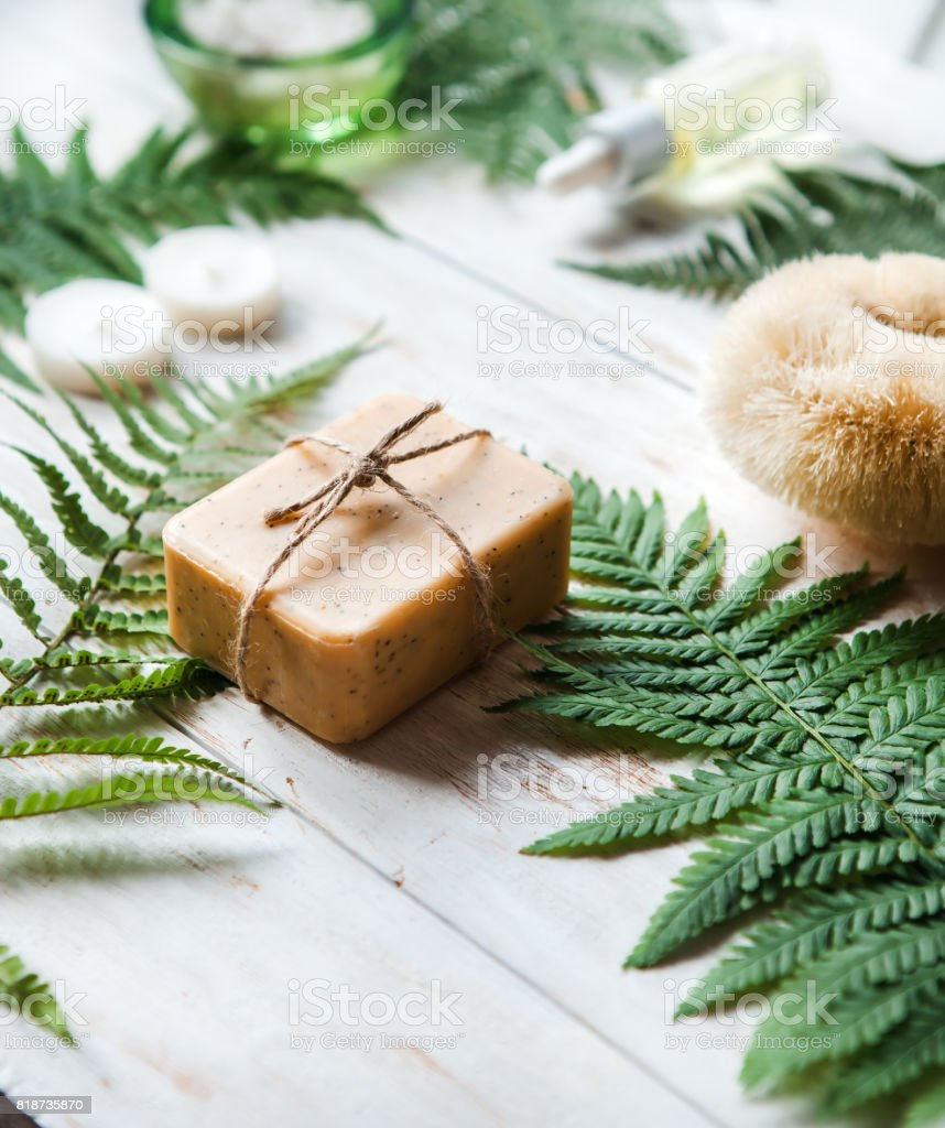 Spa concept, spa background, stylized photo, top view, with a space for a text ,flat lay Washcloth, sea salt, lotion, candles stock photo